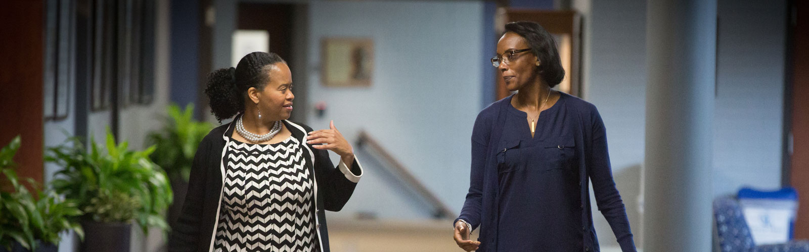 Two women walking in hallway at Creighton University